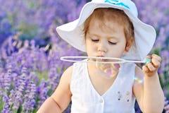 Menina da criança no campo da alfazema Imagem de Stock Royalty Free