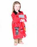 Menina da criança no traje do sapador-bombeiro Fotografia de Stock