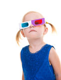 Menina da criança que desgasta os vidros 3D Imagens de Stock