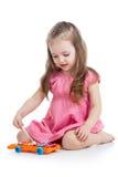 Menina da criança que joga o brinquedo musical Imagem de Stock Royalty Free