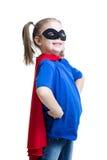 Menina da criança vestida como o superman ou o super-herói fotografia de stock
