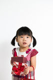 Menina da criança com caixa de presente e saco Imagem de Stock
