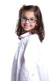 Menina da escola com avental fotos de stock royalty free