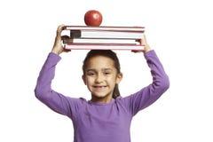Menina da escola com livros de escola Imagens de Stock