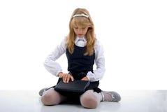 Menina da escola com portátil. fotos de stock