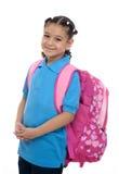 Menina da escola com trouxa Imagens de Stock Royalty Free