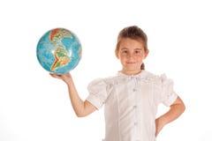 Menina da escola com um globo Fotos de Stock