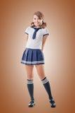 Menina da escola do estilo japonês no terno de marinheiro Fotografia de Stock