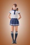 Menina da escola do estilo japonês no terno de marinheiro Foto de Stock Royalty Free