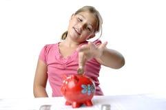 Menina da escola e banco piggy Fotografia de Stock Royalty Free