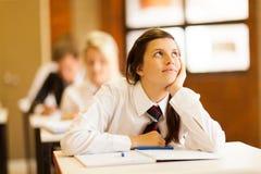 Menina da escola que daydreaming Foto de Stock Royalty Free