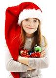 Menina da escola que guarda a decoração do Natal imagens de stock