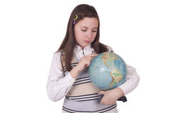 Menina da escola que guarda um globo Foto de Stock Royalty Free