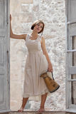 Menina da forma, empregada doméstica do leite com jarro Imagens de Stock Royalty Free