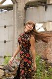 Menina da forma no vestido com flores Fotografia de Stock Royalty Free