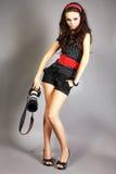 Menina da forma que levanta com câmera Fotografia de Stock Royalty Free