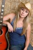 Menina da guitarra do país fotografia de stock