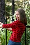 Menina da porta de jardim Imagens de Stock