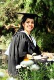 Menina da rapariga em um vestido da graduação. Fotos de Stock Royalty Free