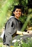 Menina da rapariga em um vestido da graduação. fotografia de stock royalty free