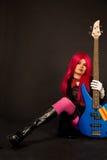 Menina da rocha com guitarra baixa Imagens de Stock Royalty Free