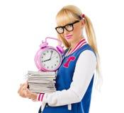 Menina da universidade que guarda livros e sorriso Imagem de Stock Royalty Free