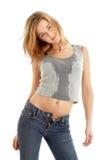 Menina das calças de brim na camisa molhada Fotografia de Stock