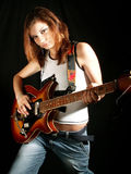 Menina de Atitude que joga a guitarra elétrica Fotos de Stock Royalty Free