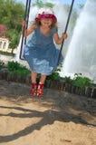 Menina de balanço feliz foto de stock royalty free