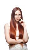 Menina de cabelo vermelha Smirking Imagens de Stock Royalty Free
