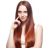 Menina de cabelo vermelha Smirking Foto de Stock