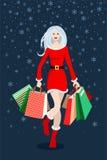 Menina de compra do Natal Foto de Stock Royalty Free
