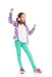 Menina de dança com fones de ouvido Fotografia de Stock Royalty Free
