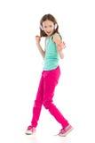 Menina de dança com fones de ouvido Imagem de Stock