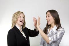 A menina de escritório e a senhora Saliência Foto de Stock
