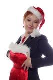 A menina de escritório está tentando no vestido do ano novo Fotografia de Stock