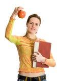 Menina de faculdade com livro e maçã Imagem de Stock Royalty Free