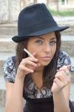 Menina de fumo Fotos de Stock Royalty Free
