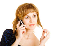 Menina de Laughting com um telefone móvel Fotografia de Stock Royalty Free