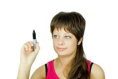 Menina de olhos azuis com um marcador Fotos de Stock