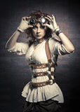 Menina de Redhair com óculos de proteção do steampunk Fotos de Stock Royalty Free