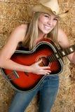 Menina de riso da guitarra imagens de stock royalty free