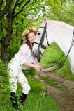 Menina de riso na grinalda floral Imagem de Stock Royalty Free