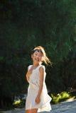 Menina de riso na luz do sol Fotos de Stock Royalty Free