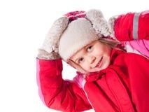 A menina de riso que desgasta macacões e mittens vermelhos Fotos de Stock