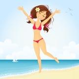 Menina de salto da praia Fotos de Stock