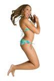 Menina de salto do biquini fotografia de stock