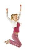 Menina de salto em calças de brim cor-de-rosa Imagem de Stock Royalty Free