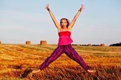 Menina de salto engraçada Imagem de Stock Royalty Free