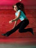 Menina de salto engraçada Fotos de Stock Royalty Free